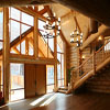 windows framed by logs in BC Canada House