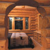 arched passage in log wall