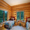 handcrafted log home guest bedroom