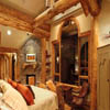log mantle in log home bedroom