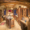 rustic log accents and arched header log in kitchen