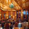 large log trusses above dining room