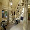 log staircase in log display home