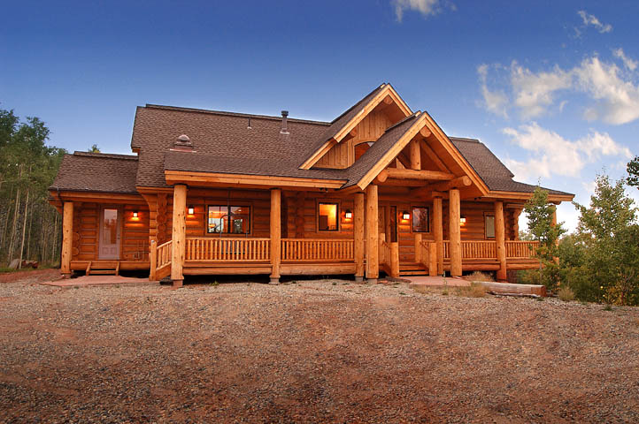 Exterior photos of log homes and timber homes for Full wrap around porch log homes