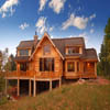 country log house with log railings on sundeck