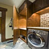 Laundry room in log house