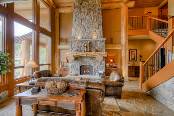 stone fireplace with log mantle